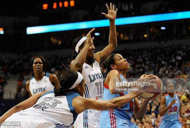Lindsey Harding of the Atlanta Dream looks to shoot against Candice Wiggins and Maya Moore of the Minnesota Lynx in Game One of the 2011 WNBA Finals...