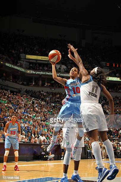 Lindsey Harding of the Atlanta Dream makes a jump shot against Candice Wiggins the Minnesota Lynx in Game One of the 2011 WNBA Finals on October 2...