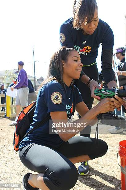 Lindsey Harding of the Los Angeles Sparks and Tina Tompson help build during the NBA Cares AllStar Day of Service PLAY with KaBOOM as part of the...