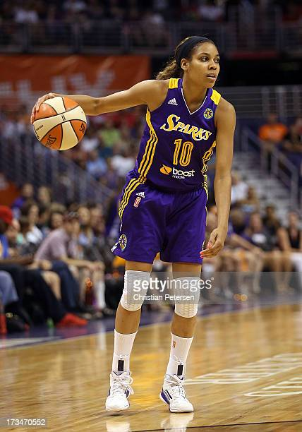 Lindsey Harding of the Los Angeles Sparks handles the ball during the WNBA game against the Phoenix Mercury at US Airways Center on July 14 2013 in...