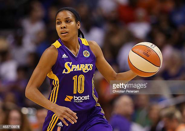 Lindsey Harding of the Los Angeles Sparks handles the ball during the first half of the WNBA game against the Phoenix Mercury at US Airways Center on...