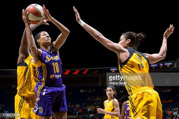 Lindsey Harding of the Los Angeles Sparks shoots against Nicole Powell of the Tulsa Shock during the WNBA game on July 11 2013 at the BOK Center in...