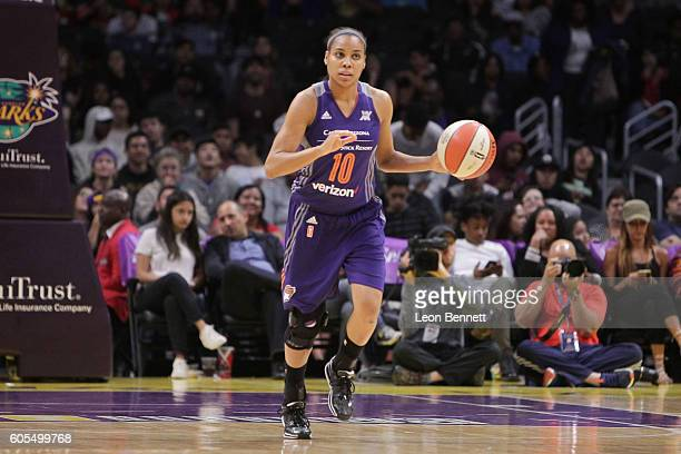 Lindsey Harding of the Phoenix Mercury handles the ball against the Los Angeles Sparks during a WNBA basketball game at Staples Center on September...