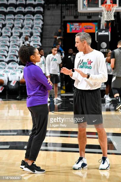 Lindsey Harding of the Sacramento Kings talks with Chip Engelland of the San Antonio Spurs before the game on December 6 2019 at the ATT Center in...