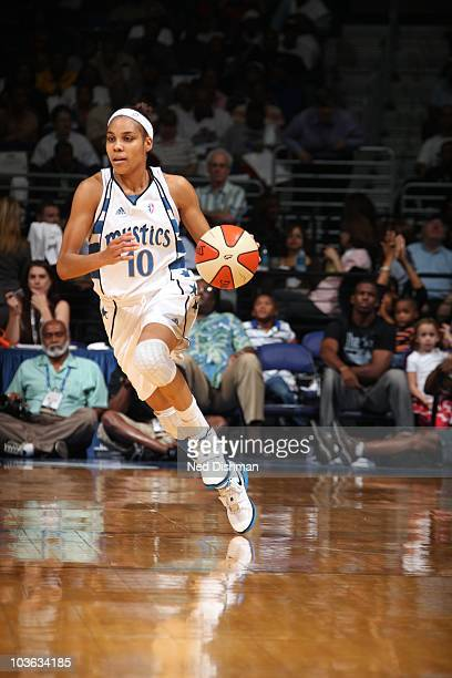 Lindsey Harding of the Washington Mystics brings the ball up court during the WNBA game against the New York Liberty at the Verizon Center on August...