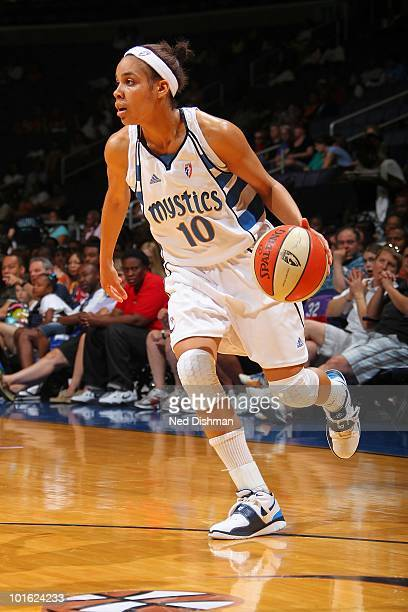 Lindsey Harding of the Washington Mystics moves the ball against the Connecticut Sun during the WNBA game at the Verizon Center on May 30 2010 in...