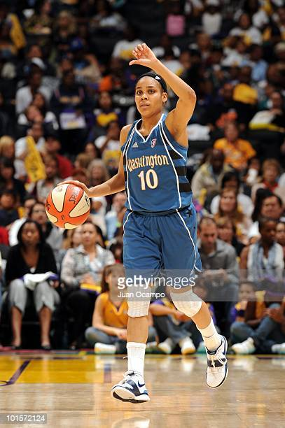 Lindsey Harding of the Washington Mystics moves the ball up court during the game against the Los Angeles Sparks at Staples Center on May 28 2010 in...