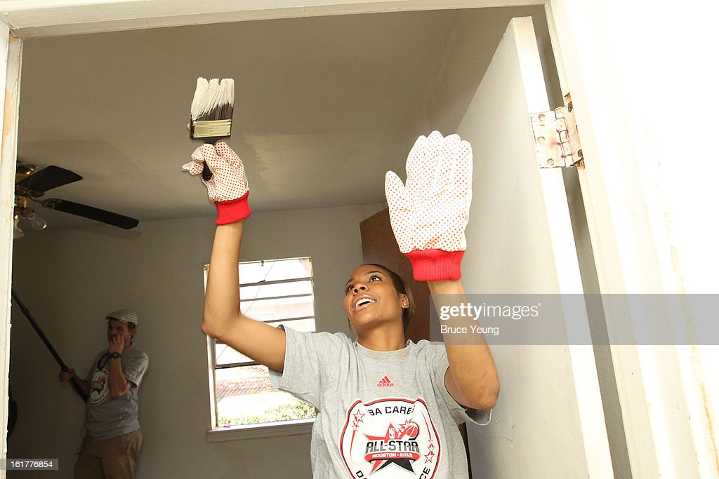 Lindsey Harding of the WNBA Los Angeles Sparks paints the door at the 2013 NBA Cares Day of Service at the LIVE Project on February 15, 2013 in Houston, Texas.
