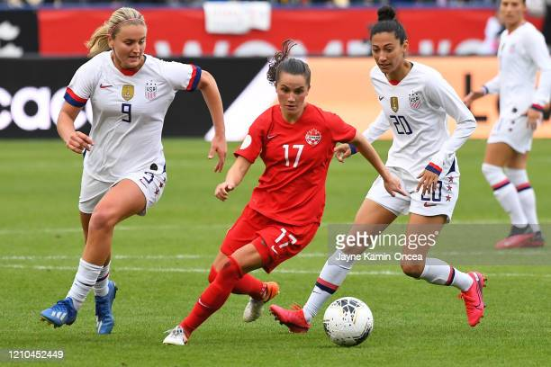 Lindsey Horan and Christen Press of the United States and Jessie Fleming of Canada chase down the ball for the ball during the 2020 CONCACAF Women's...