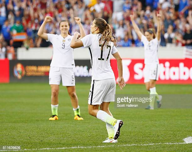 Lindsey Horan and Tobin Heath of the United States celebrate after Heath scored a second half goal against Canada during the Championship final of...