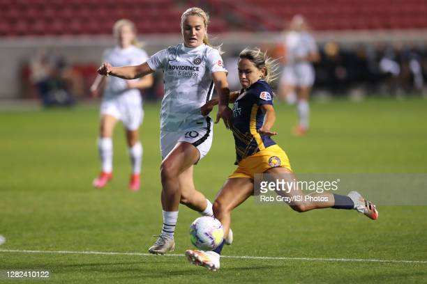 "Lindsey Horan of Portland Thorns FC defends Lo""u2019eau LaBonta of Utah Royals FC with a shot on goal during a game between Portland Thorns FC and..."