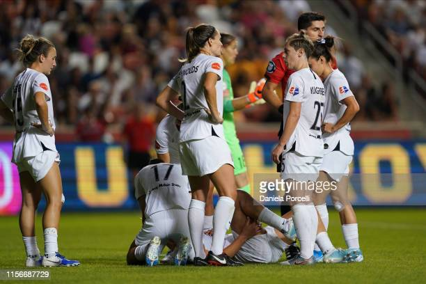 Lindsey Horan of Portland Thorns FC goes down after scoring a goal with her teammates around checking on her during the NWSL game between Utah Royals...
