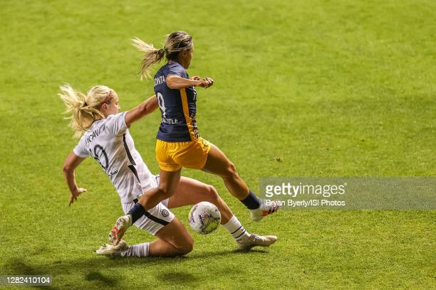 "Lindsey Horan of Portland Thorns FC plays for the ball against Lo""u2019eau LaBonta of Utah Royals FC during a game between Portland Thorns FC and..."