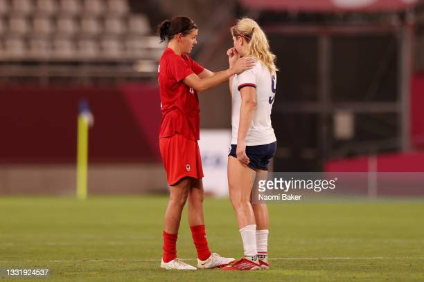 Lindsey Horan of Team United States is consoled by Christine Sinclair of Team Canada following the Women's Semi-Final match between USA and Canada on...