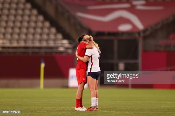 Lindsey Horan of Team United States is consoled by Vanessa Gilles of Team Canada after the Women's Semi-Final match between USA and Canada on day ten...