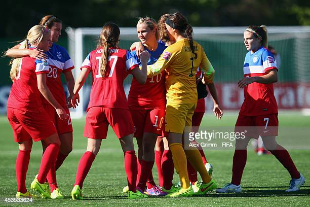Lindsey Horan of the United States celebrates her team's first goal with team mates during the FIFA U20 Women's World Cup Canada 2014 group B match...