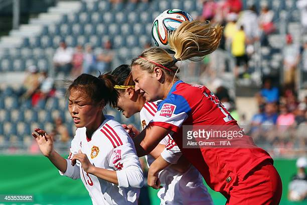 Lindsey Horan of the United States is challenged by Li Mengwen of China during the FIFA U20 Women's World Cup Canada 2014 group B match between the...
