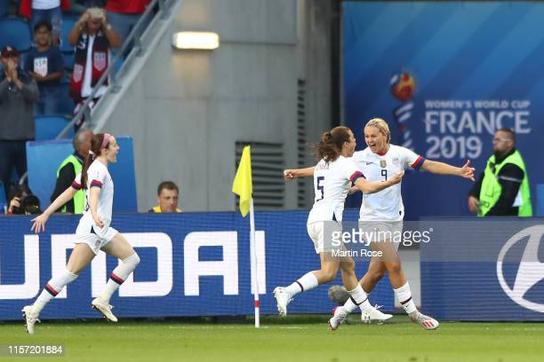 Lindsey Horan of the USA celebrates with teammate Kelley O'hara after scoring her team's first goal during the 2019 FIFA Women's World Cup France...