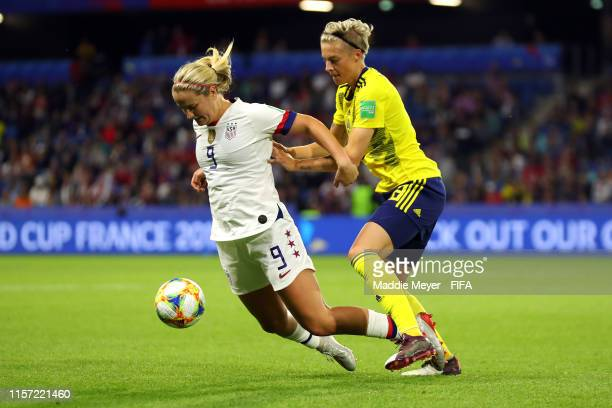 Lindsey Horan of the USA is challenged by Lina Hurtig of Sweden during the 2019 FIFA Women's World Cup France group F match between Sweden and USA at...