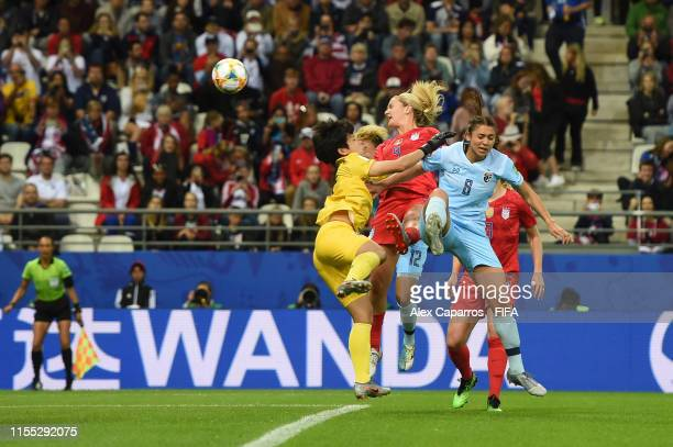 Lindsey Horan of the USA is challenged by Sukanya Chor Charoenying of Thailand during the 2019 FIFA Women's World Cup France group F match between...