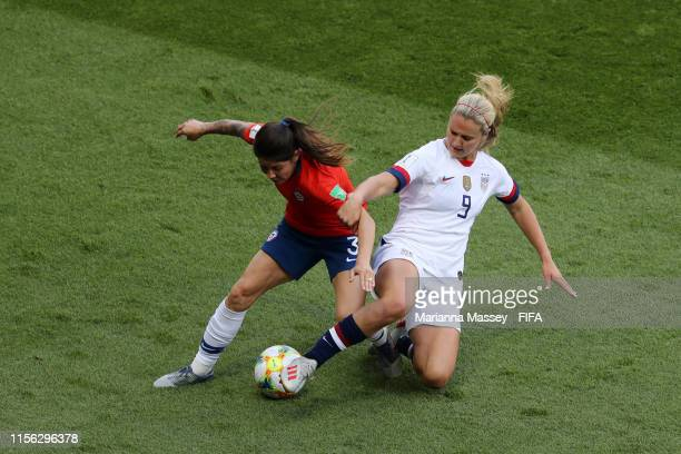 Lindsey Horan of the USA tackles Carla Guerrero of Chile during the 2019 FIFA Women's World Cup France group F match between USA and Chile at Parc...