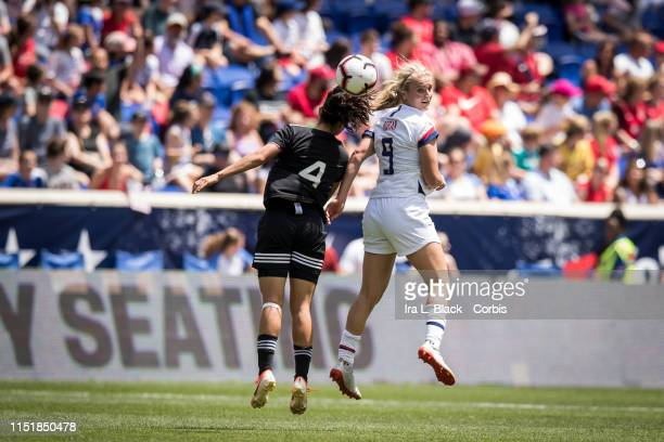 Lindsey Horan of United States goes up for the ball against Rebeca Bernal of Mexico during the International Friendly match the US Women's National...