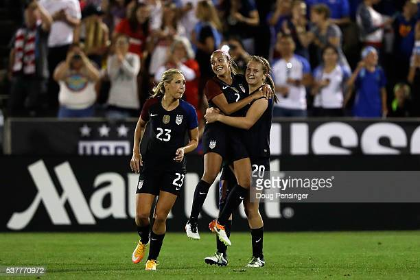 Lindsey Horan of United States of America celebrates her goal against Japan in the 89th minute to take a 32 lead with Mallory Pugh and Allie Long...