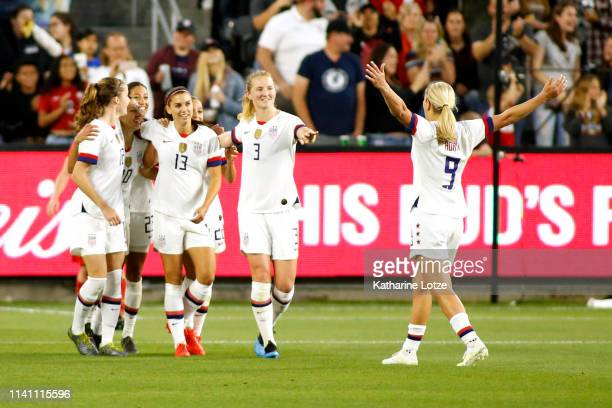 Lindsey Horan of United States Women's National Team celebrates Alex Morgan following Morgan's goal during the second half of a game against the...