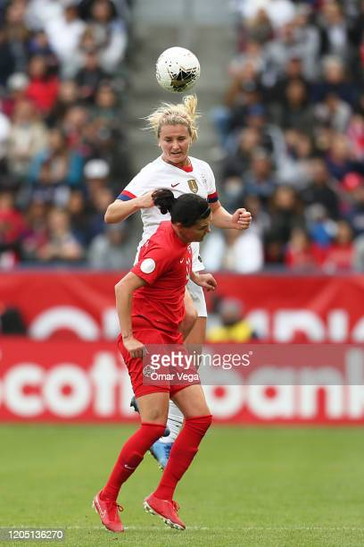 Lindsey Horan of USA and Captain Christine Sinclair of Canada head the ball during the Final game between Canada and United States as part of the...