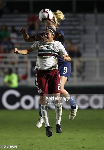 Lindsey Horan of USA goes after a ball against Kenti Robles of Mexico during the Group A CONCACAF Women's Championship at WakeMed Soccer Park on...