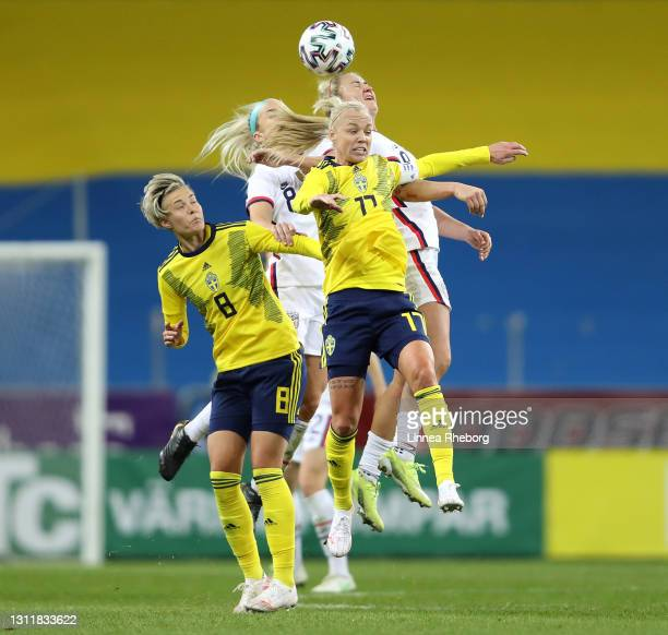 Lindsey Horan of USA wins the header ahead of Caroline Seger of Sweden and Julie Ertz of USA during the Women's International Friendly between Sweden...
