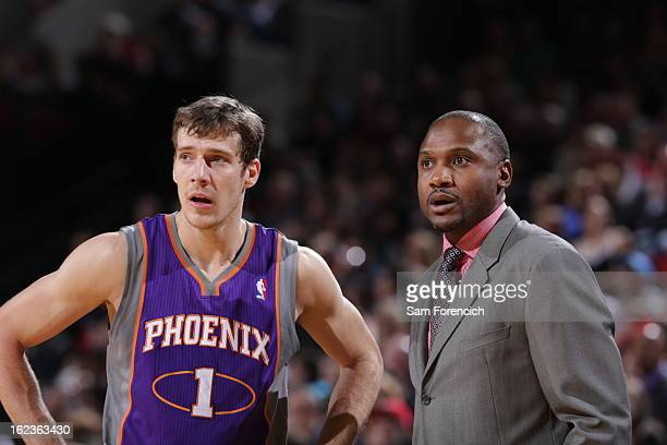 Lindsey Hunter and Goran Dragic of the Phoenix Suns discuss a call against the Portland Trail Blazers on February 19 2013 at the Rose Garden Arena in...