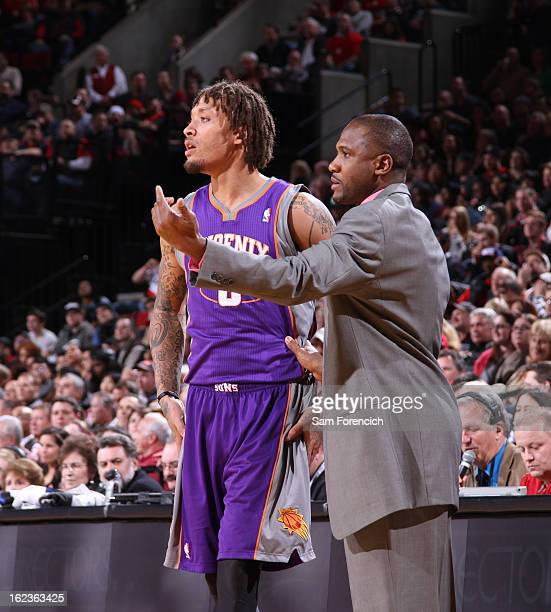 Lindsey Hunter and Michael Beasley of the Phoenix Suns discuss a play against the Portland Trail Blazers on February 19 2013 at the Rose Garden Arena...