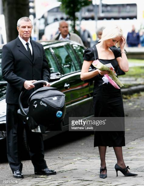Lindsey Hunter looks on with baby Evie Rose ahead of Paul Hunter's funeral at Leeds Parish Church on October 19 2006 in Leeds England The threetime...