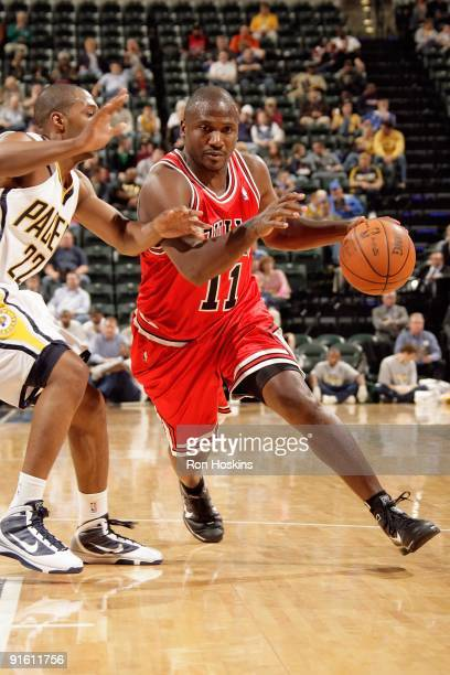 Lindsey Hunter of the Chicago Bulls drives against AJ Price of the Indiana Pacers during the preseason game on October 2 2009 at Conseco Fieldhouse...
