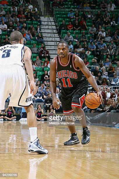Lindsey Hunter of the Chicago Bulls drives the ball against Eric Maynor of the Utah Jazz during the game on November 26 2009 at EnergySolutions Arena...