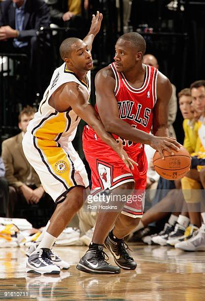 Lindsey Hunter of the Chicago Bulls looks to pass the pall under pressure against AJ Price of the Indiana Pacers during the preseason game on October...