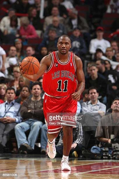 Lindsey Hunter of the Chicago Bulls moves the ball against the Miami Heat during the game on March 26 2009 at the United Center in Chicago Illinois...
