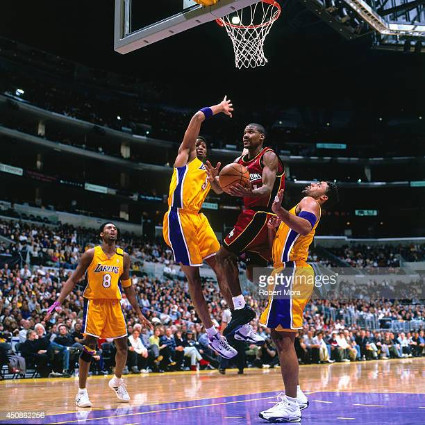 Lindsey Hunter of the Detroit Pistons drives to the basket against the Los Angeles Lakers on December 12 2000 at Staples Center in Los Angeles CA...