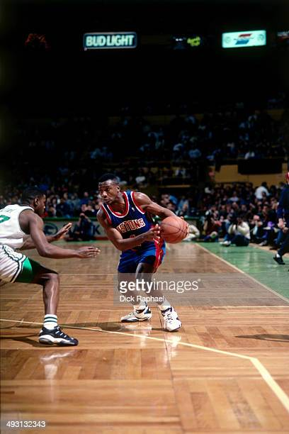 Lindsey Hunter of the Detroit Pistons looks to drive against the Boston Celtics during a game played circa 1994 at the Boston Garden in Boston...