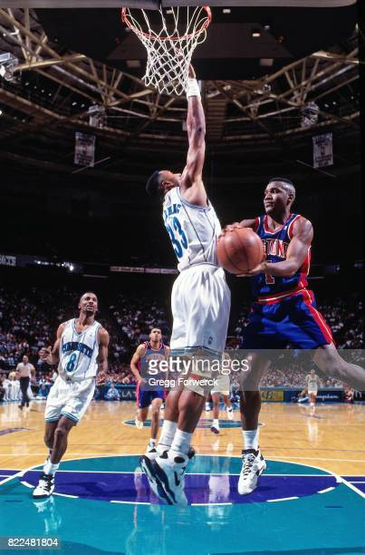 Lindsey Hunter of the Detroit Pistons looks to pass against the Charlotte Hornets during a game at the Charlotte Coliseum in Charlotte North Carolina...