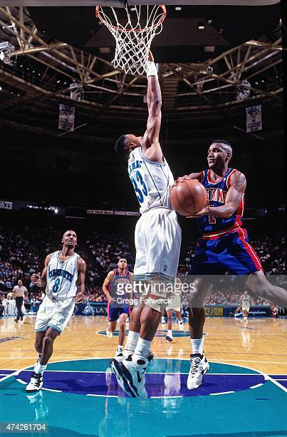 Lindsey Hunter of the Detroit Pistons passes the ball against the Charlotte Hornets on December 27 1993 at Charlotte Coliseum in Charlotte NC NOTE TO...