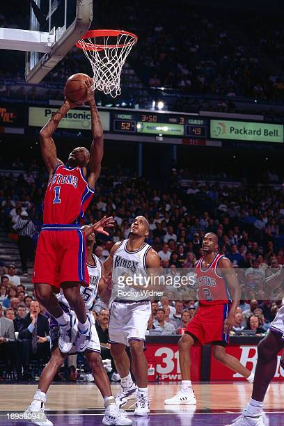 Lindsey Hunter of the Detroit Pistons shoots the ball against the Sacramento Kings during a game played on October 17 1996 at Arco Arena in...