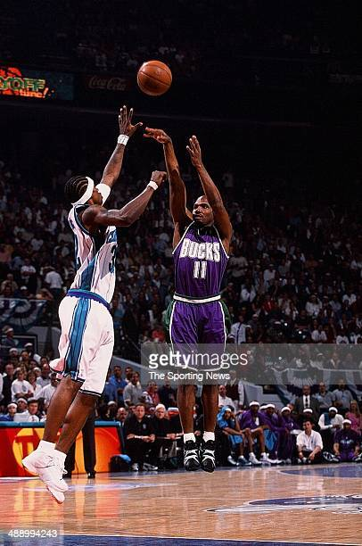 Lindsey Hunter of the Milwaukee Bucks puts a shot up over Eddie Robinson of the Charlotte Hornets in Game Six of the Eastern Conference Semifinals on...