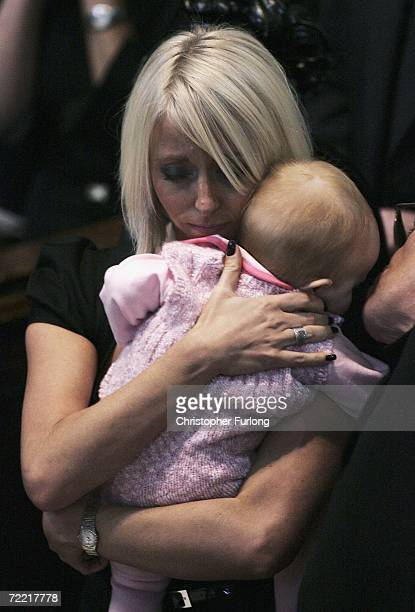Lindsey Hunter the wife of snooker star Paul Hunter cuddles their daughter Evie Rose during his funeral at Leeds Parish Church on October 19 2006 in...