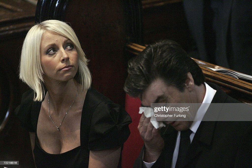 Lindsey Hunter, the wife of snooker star Paul Hunter, looks on as his father Alan Hunter wipes his eye during his funeral at Leeds Parish Church on October 19, 2006 in Leeds, England. The three-time Masters champion lost his battle to cancer on October 6, 2006 at the age of 27, leaving behind wife, Lindsey, and a daughter, Evie Rose.