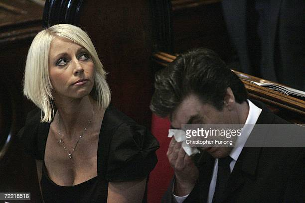 Lindsey Hunter the wife of snooker star Paul Hunter looks on as his father Alan Hunter wipes his eye during his funeral at Leeds Parish Church on...