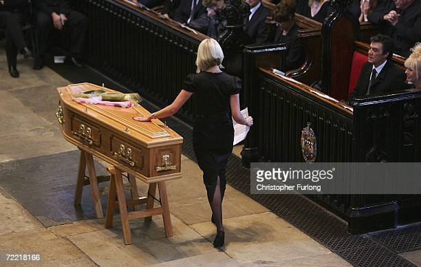 Lindsey Hunter the wife of snooker star Paul Hunter touches his coffin during his funeral at Leeds Parish Church on October 19 2006 in Leeds England...