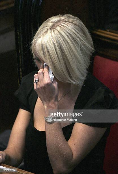 Lindsey Hunter the wife of snooker star Paul Hunter wipes her eye during his funeral at Leeds Parish Church on October 19 2006 in Leeds England The...