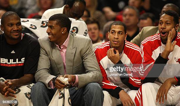 Lindsey Hunter Tyrus Thomas Jannero Pargo and James Johnson of the Chicago Bulls sit on the bench during a game against the Boston Celtics at the...